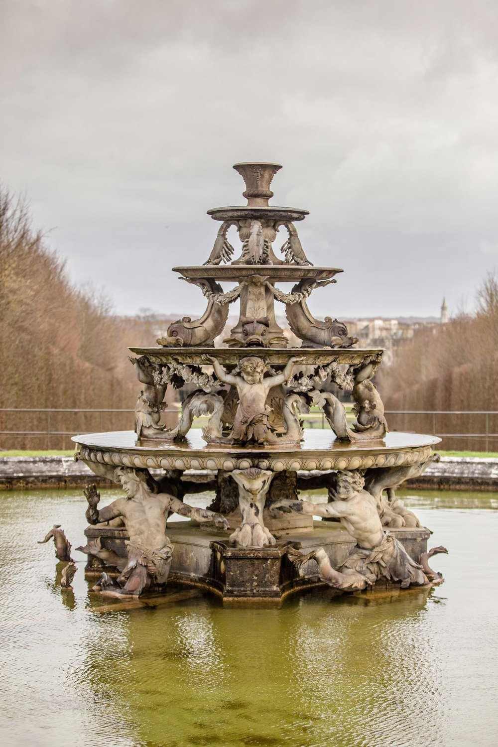 One of the fountains in the gardens of Versailles