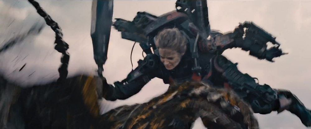 Emily Blunt uses a scifi sword against an alien in  Edge of Tomorrow.