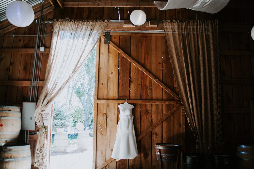 wedding dress in winery barn wide angle