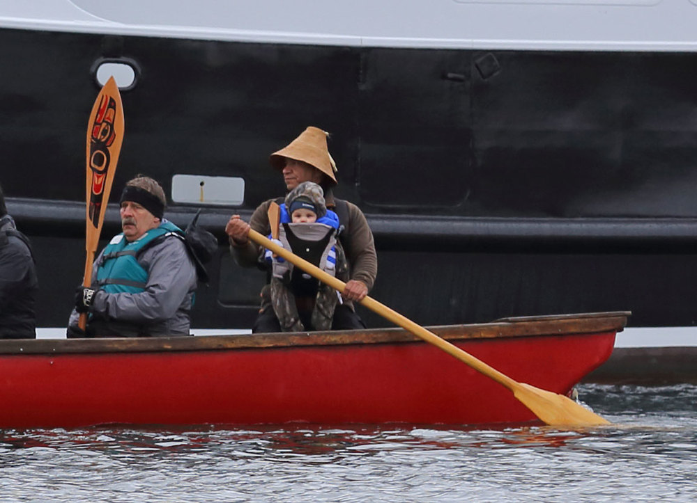One People Canoe Society founder Doug Chilton including his child in this cultural event.