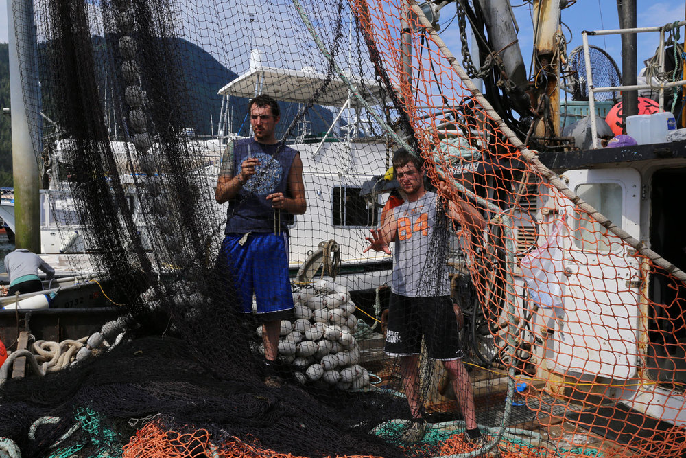 Men working seine net on REBEL ISLE Petersburg Alaska southeast  commercialfishing boat fishermen