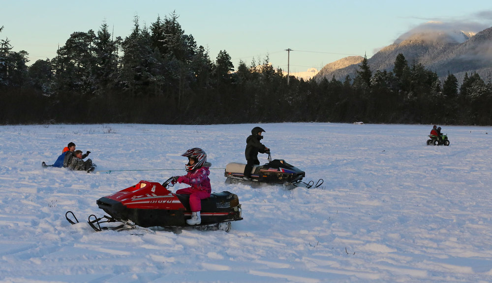 Kids snow snowmobiling sledding Southeast Alaska