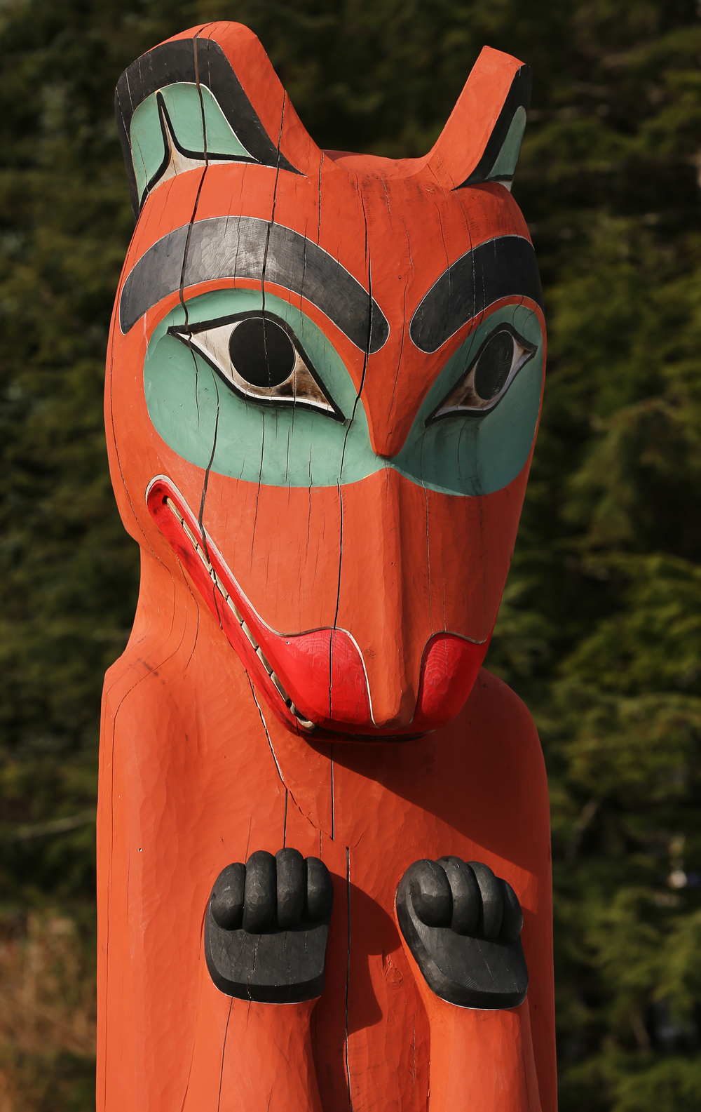 "This bear totem is a reproduction carved by Donald Varnell, who says that he likes to ""push the form."" He brings in strong relief, lively curves, and an animated tension to his work."