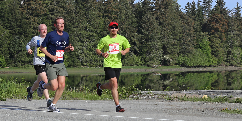 Jesse Agner (#16), Steve Miller (#2), and Jonathon Kreiss-Tompkins (#294) running by the perfectly calm Klawock Inlet.