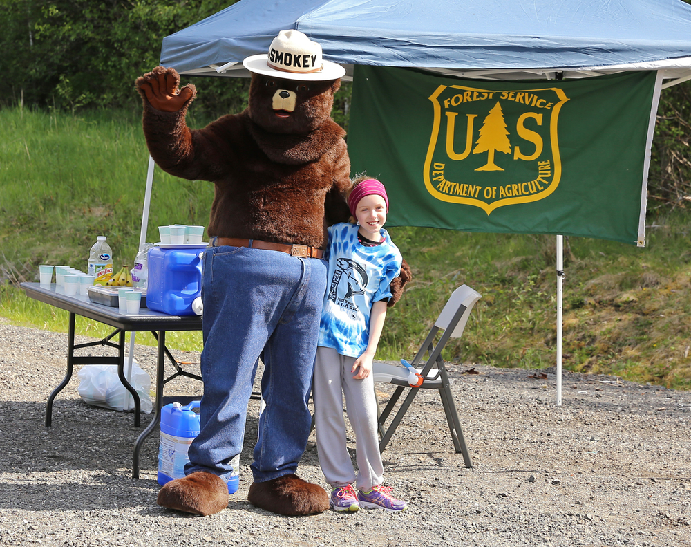 Rylee and Smokey Bear at the US Forest Service aid station.