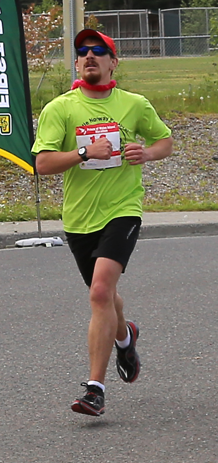 Jesse Agner of Petersburg, Alaska  at the finish line taking first for the full marathon.