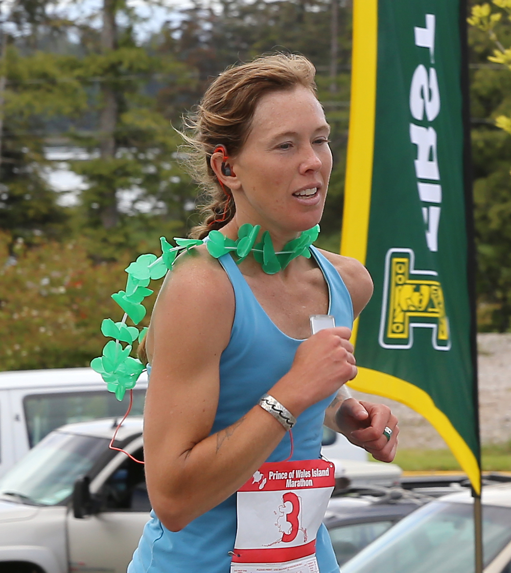 Jessica Goodrich of Klawock, Alaska crossing the finish line to win the 2014 women's division of the Prince of Wales Island Marathon.