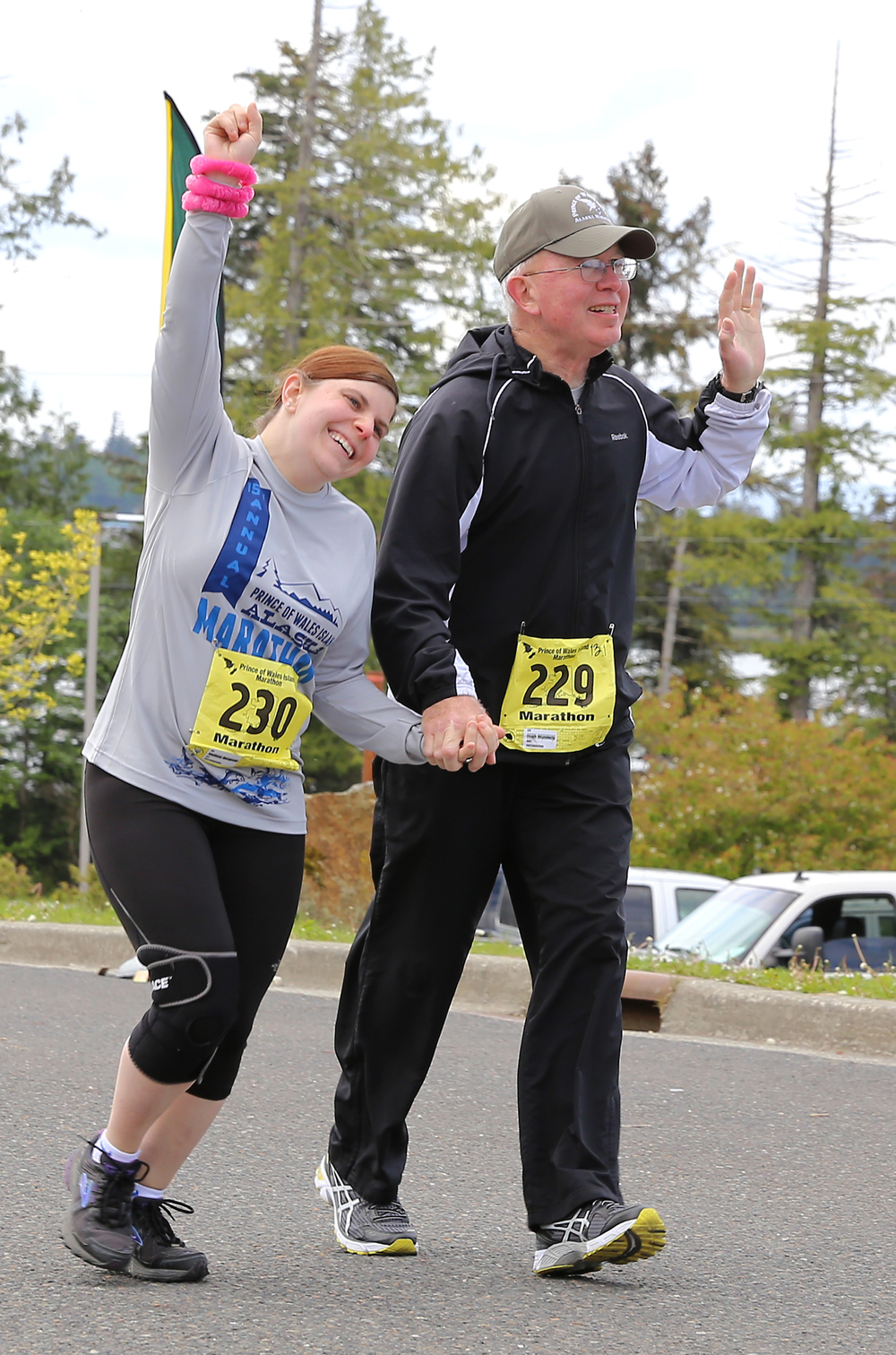 Hugh Wonderly of Indianapolis, Indiana and his daughter Melissa Bergtold of Craig, Alaska triumphantly finish the half-marathon.