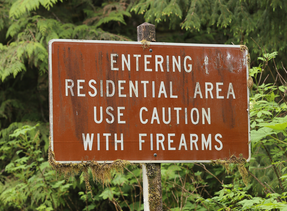 sign Alaska guns firearms posted funny