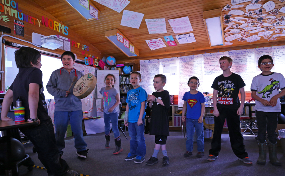 Hollis School students Isaac, Myles, Chloe, Kolton, Tyler, C.J., Ben, and Jose honor their guests with songs.