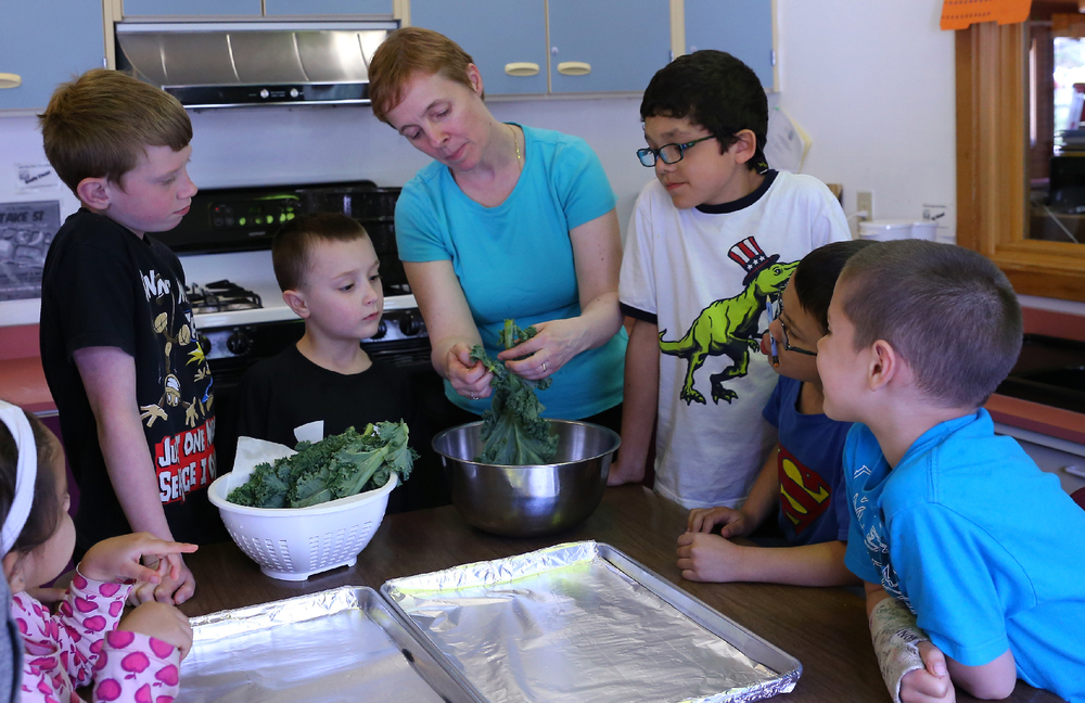 Sarah taught the students how to make kale chips! Left to right: Sophia, Ben, Tyler, Sarah, Jose, C.J., and Kolton.