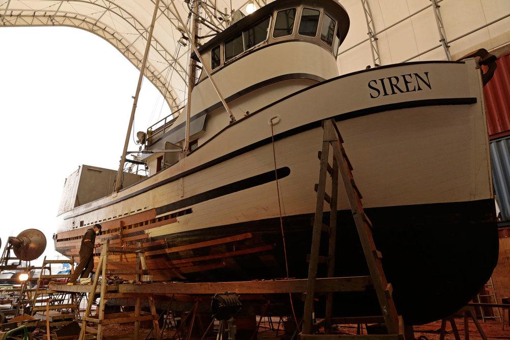 Wood fishing boat FV Siren Petersburg Wrangell Marine Service Center shipyard boatyard replacing planks shipwright boatwright seiner longliner troller