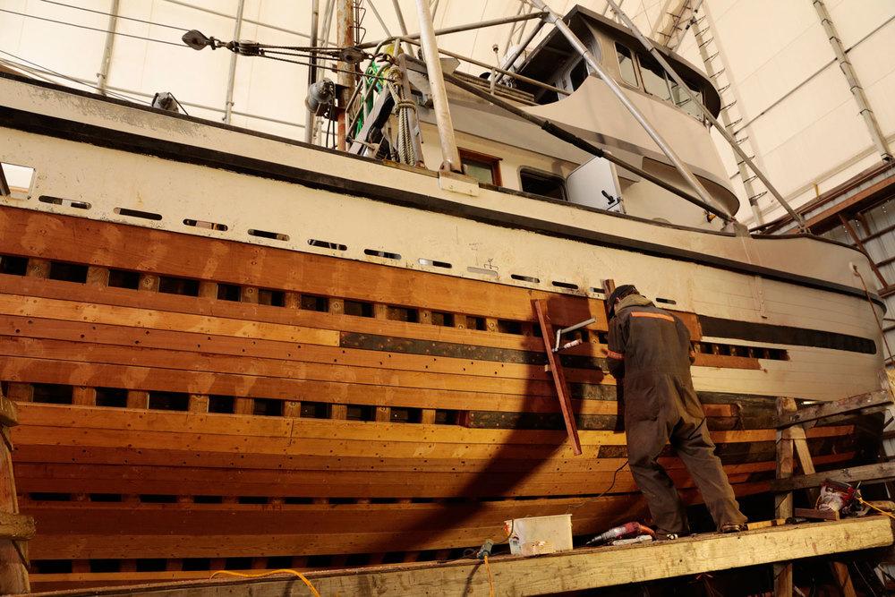 Replanking replacing planks on wood fishing boat FV Siren Petersburg Wrangell boatyard shipyard marine service center seiner longliner troller