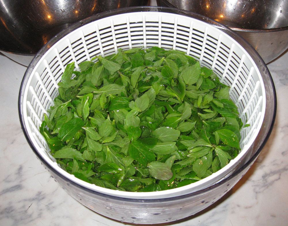 Rinsing in a salad spinner is nice because the leaves can be lifted out in the colander and the grit stays in the bowl.