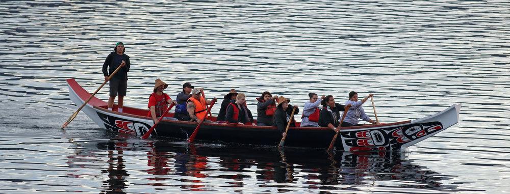 A Haida canoe arriving at Kasaan, Alaska.