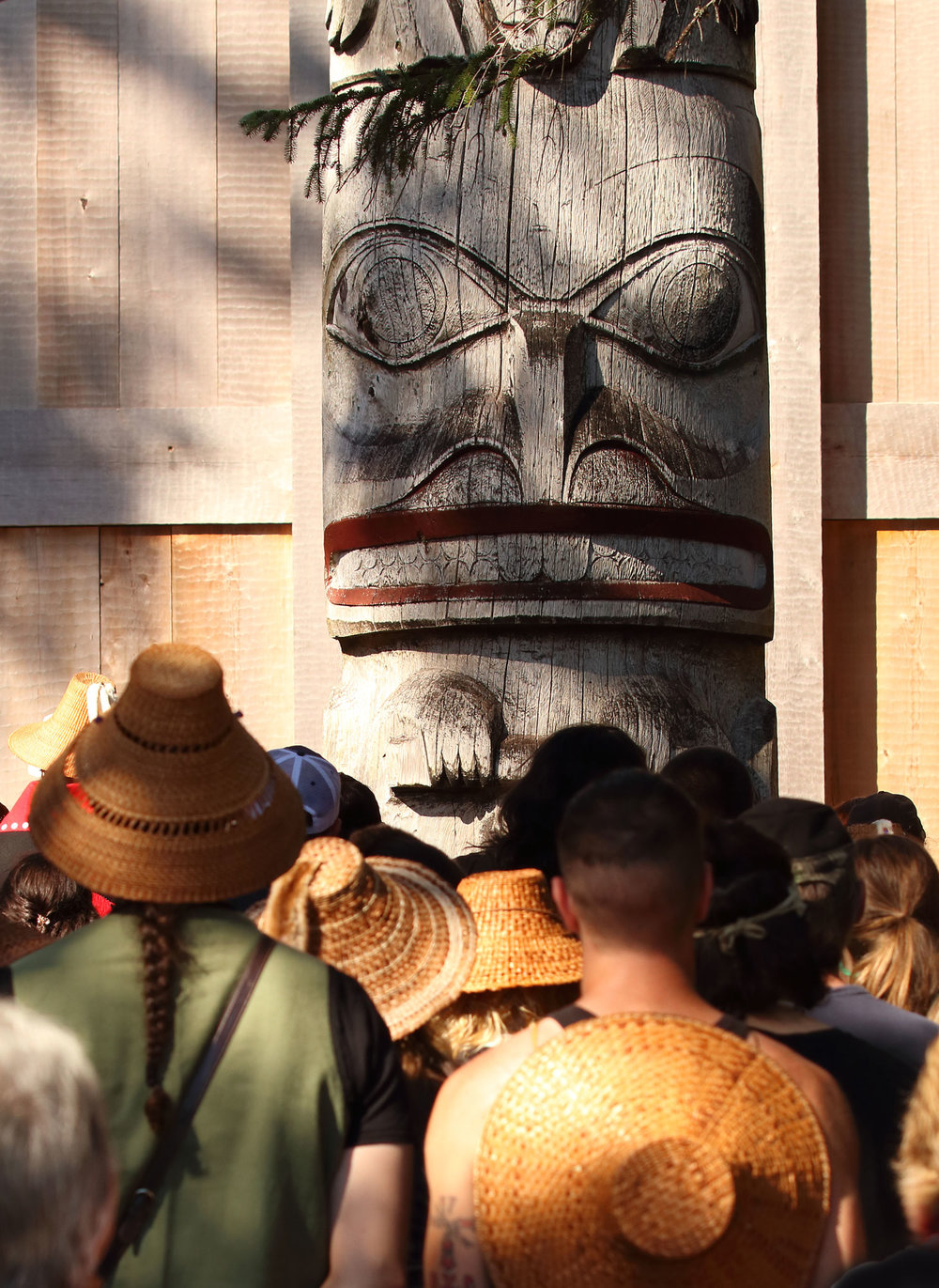 There was a big crowd at the Whale House. The frontal totem in this photo is huge and towers over 50 feet high.