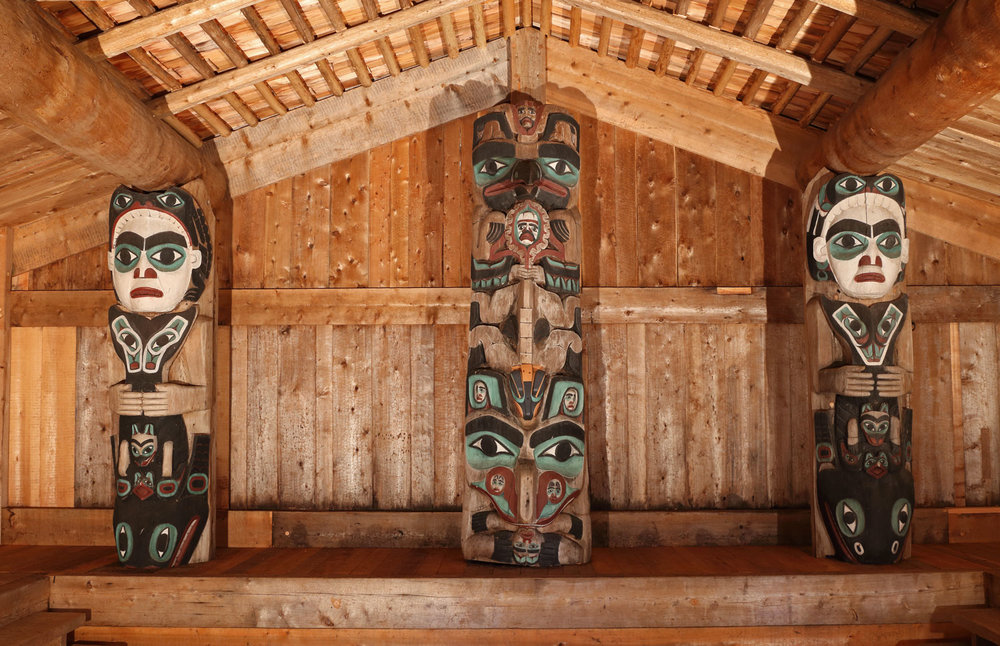 Inside the Whale House there are three totem poles that tell Haida stories.