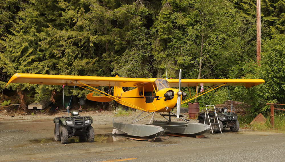 Piper J3 Cub tied down to 4-wheeler atv quads in Southeast Alaska