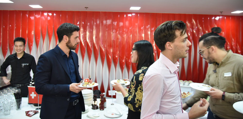 The participants made meaningful connections around finger food and drinks after the presentation.