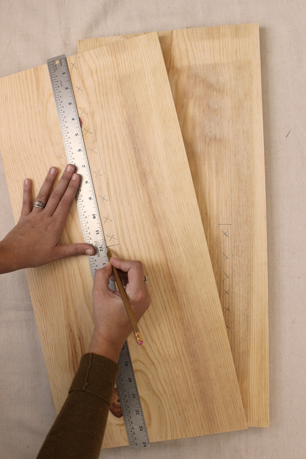 "Step 1: On each board, measure out and mark a rectangle that is 12"" long and approximately ¾"" tall* and 2"" from one of the longer edges of each of the boards and adjacent to one of the shorter edges, as shown.  *It is very important that the heights of the rectangles are exactly or only marginally larger than the thickness of the planks."