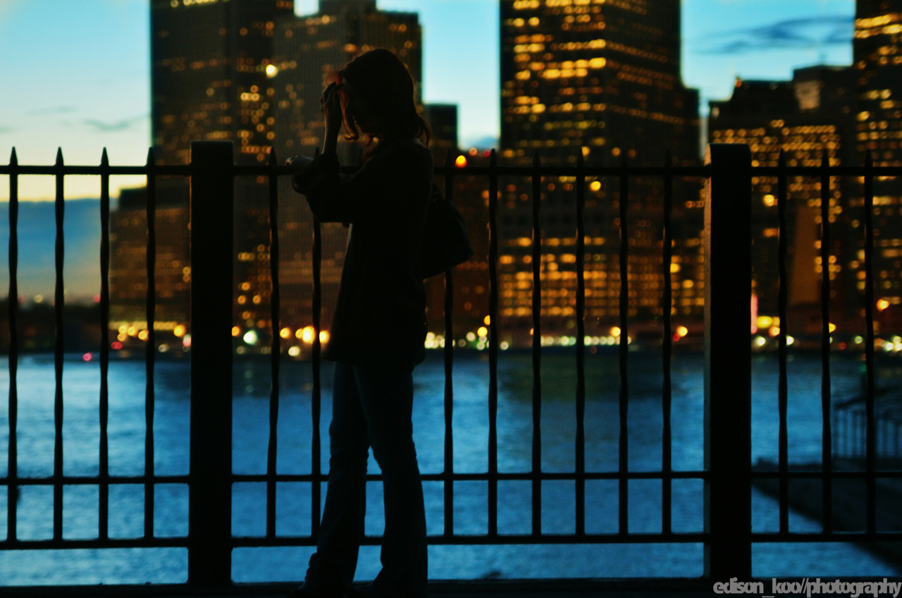 Silhouettes by City Lights at Dusk