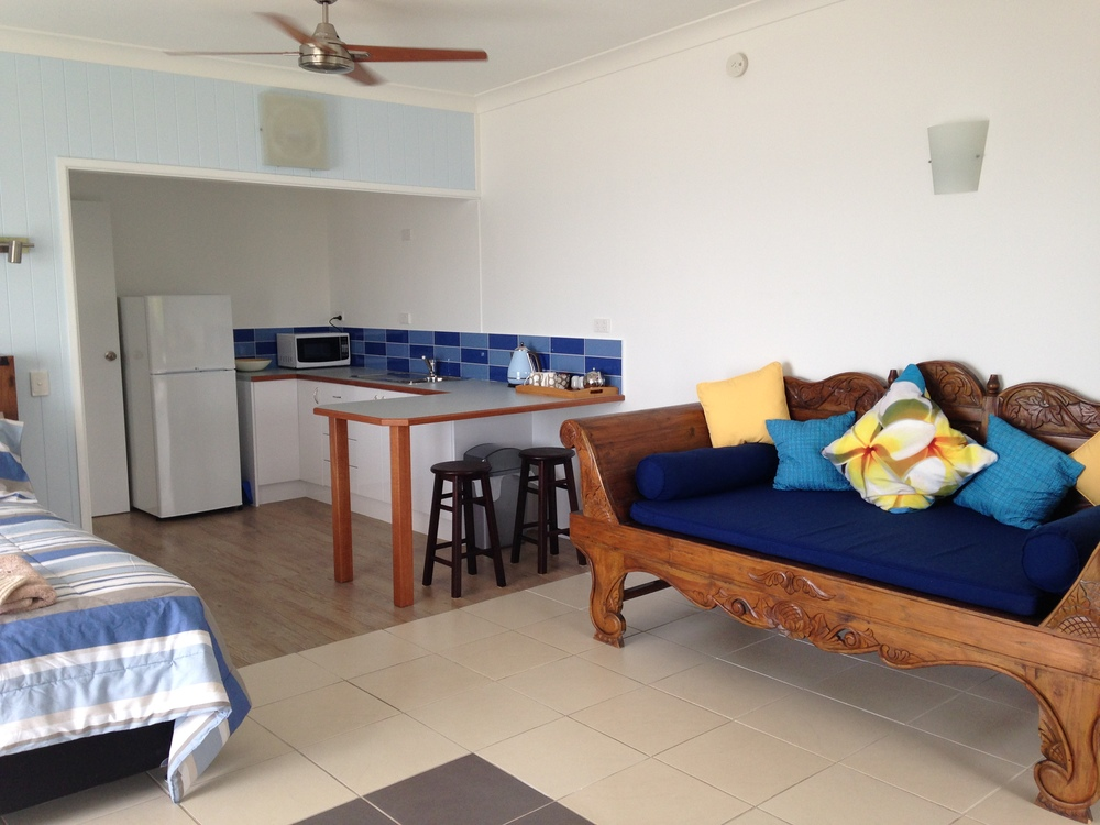 Relax on the day bed in the Studio Apartment with Ocean View