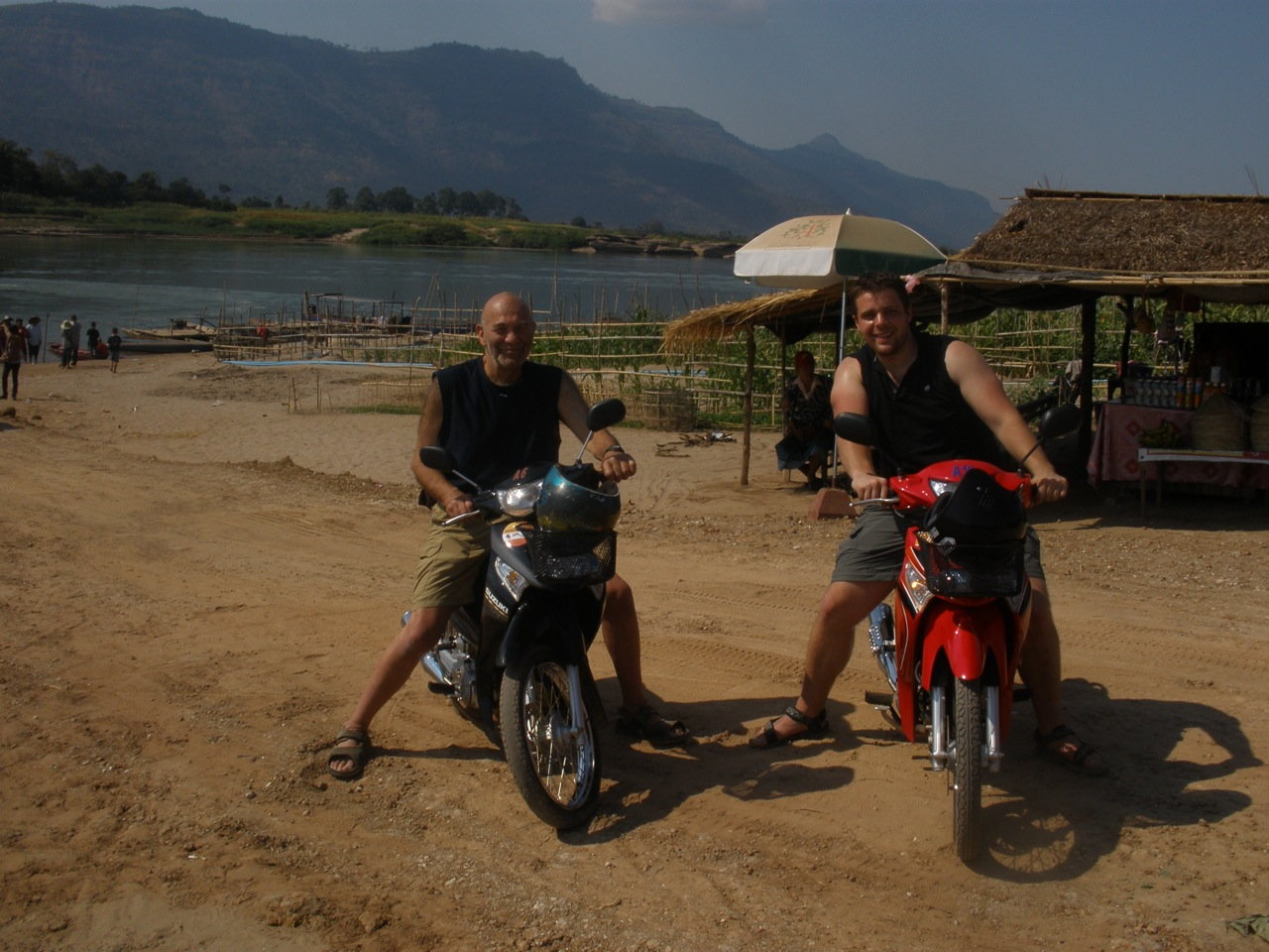 loren and bruce at the mekong ferry crossing