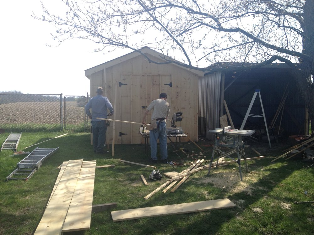 Jay and his dad building our awesome garden shed. (See also the building to the right, which is proof that they build ugly things using scrap metal if they are not supervised). Jay's dad helped us with so many things in our house and even taught me how to lay tiles one day!