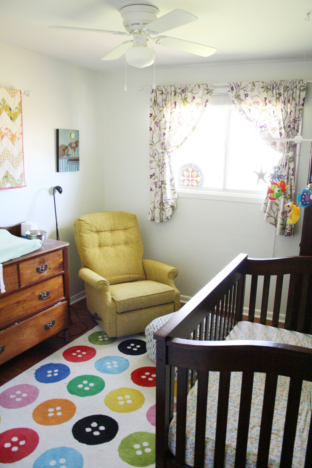 Molly's nursery! I still love this room so much. The dresser was mine when I was little, we thrifted the chair, I made the curtains and the mobile and many of my fabulously artsy friends made her artwork!