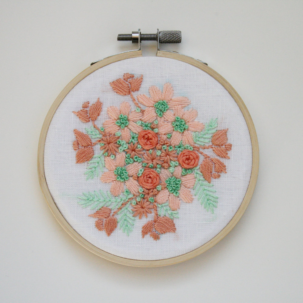 Peach and mint floral embroidery on white cotton