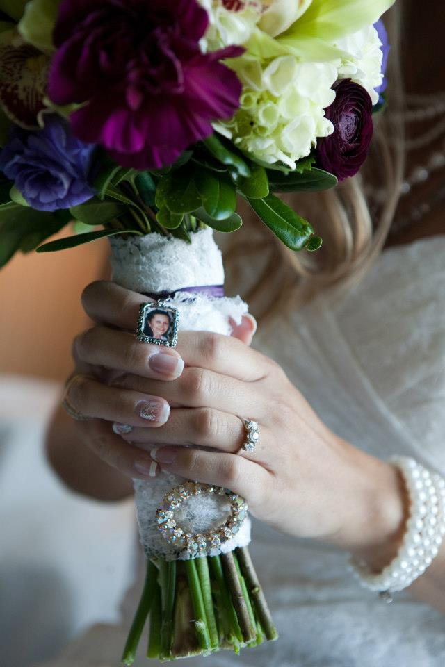 Teresa carried her moms broach and picture charm with her down the aisle.