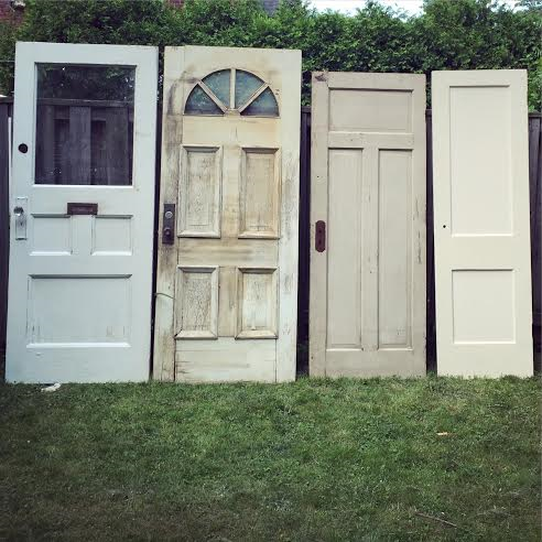 Vintage doors!!  These four unique old doors are perfect for the outdoor, the rustic, the vintage of weddings!!   Place them at the altar, draped with linen for a custom ceremony backdrop.  Or place them at the end of the aisle creating ceremony entrance décor.   Use them at the reception as a focal point for your cake table,  seating chart...so much more.