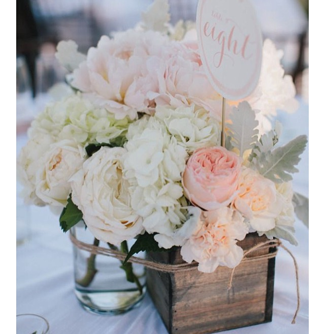 Wooden boxes in all shapes and sizes.  Pair up with glass vessels or mason jars!!  Fill them with flowers, spilling over onto the table.  Perfect for any wedding!!  These can be rented or purchased - great as guest giveaway at the end of the night :)
