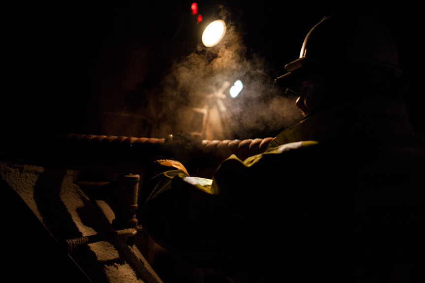 Trucker Derek Cross loads a hose onto his water truck at 3 AM after offloading water for a frack site.