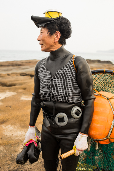 "Haenyeo (해녀), which translates into ""sea women"", are an icon on Jeju Island. These women free-dive for sea urchins, abalone, octopi, and other seafood. They are renown for their strong wills, being able to hold their breath for up to two minutes diving to depths of 20 meters."