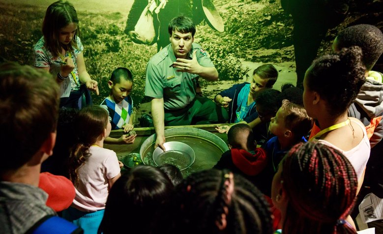 Park ranger Kevin Mahe gives a demonstration on panning for gold to fourth-graders from Hawthorne Elementary last month. They're at the Klondike Gold Rush National Historical Park in Seattle's Pioneer Square... (Erika Schultz / The Seattle Times)