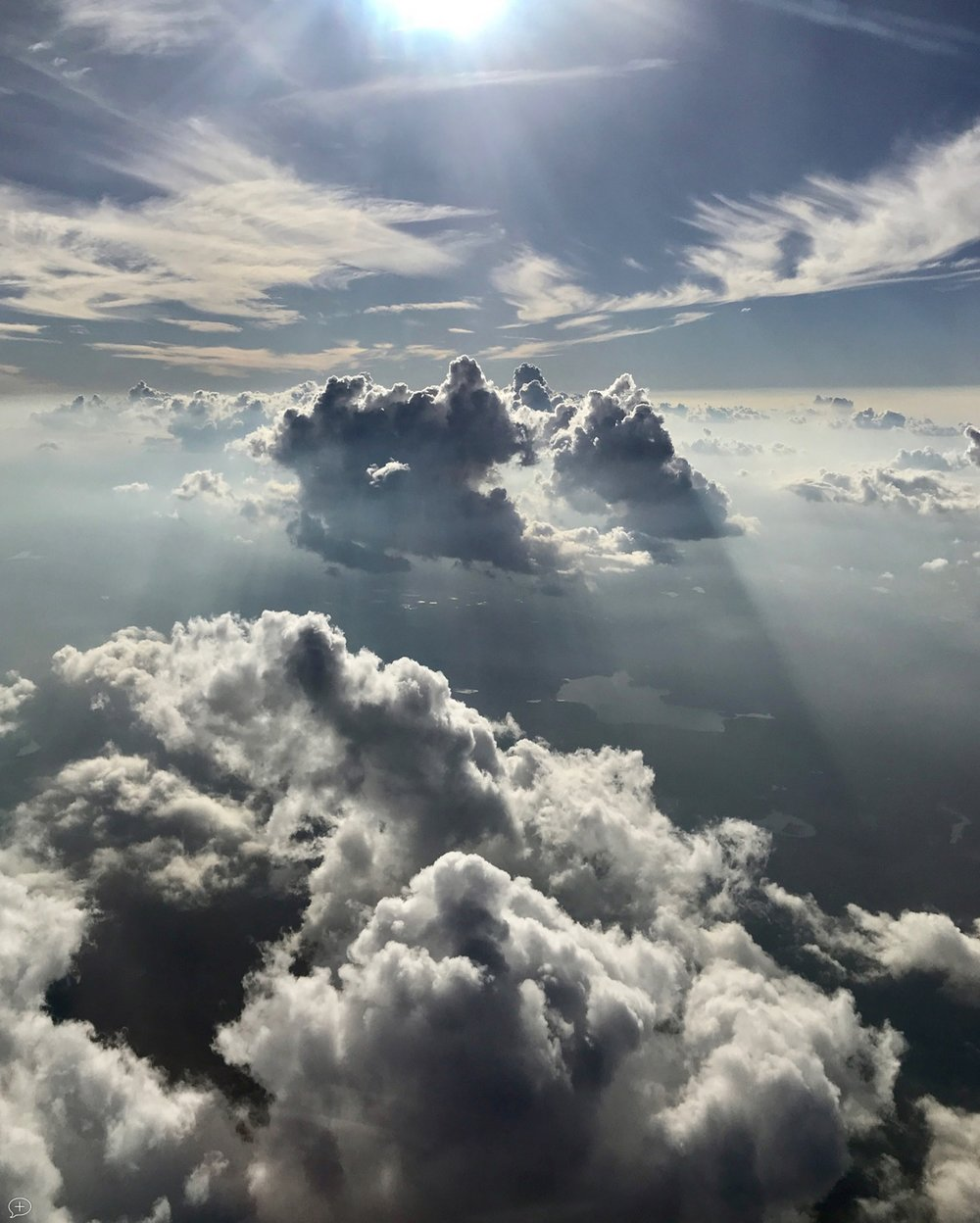 """16.  Clouds above the Appalachians , iPhone 7+, 2017. En route to Philadelphia. (Canvas Photo, 16"""" x 20,""""). I've flown this route many times, but never seen such a display of clouds above us and below. Needless to say, it wasn't a smooth flight.  ©2017 Sean Walmsley"""