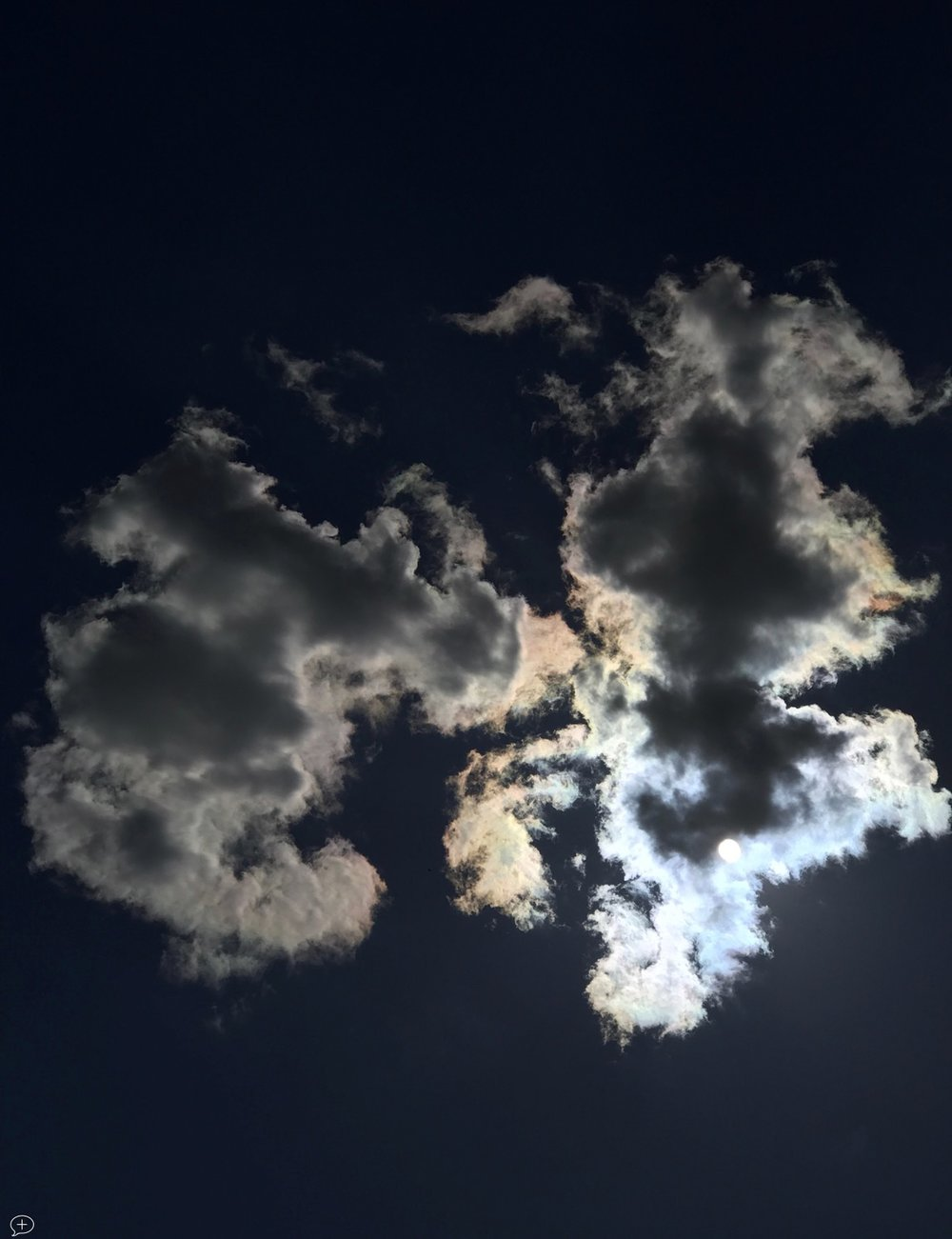 """17. S un Behind Clouds , iPhone 7+, 2017. Saratoga Springs, NY. (Canvas Photo, 16"""" x 20,""""). As you probably have already gathered, I have a fascination for clouds—made legitimate through a membership of the British Cloud Appreciation Society. This one was shot from the patio at the back of my house.  ©2017 Sean Walmsley"""