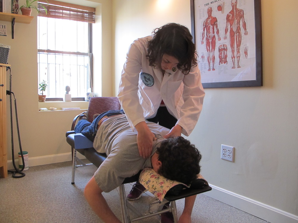 Assessing the cervicothoracic junction, the area of the spine where the neck meets the ribcage.