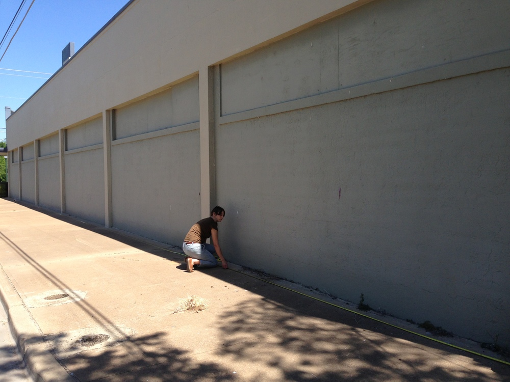 Ashley Laird measuring our wall, roughly 18' x 121' East Waco Public Library