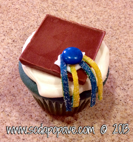 This is the version using white frosting to attach the tassels and M&M as an example