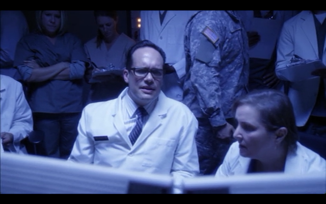 Diedrich Bader as the surgeon behind Buster's monster hand transplant.