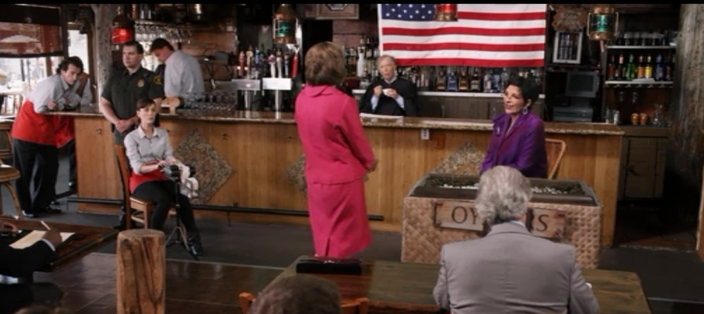 Lucille 1 puts Lucille 2 on the stand--pink vs. plum.