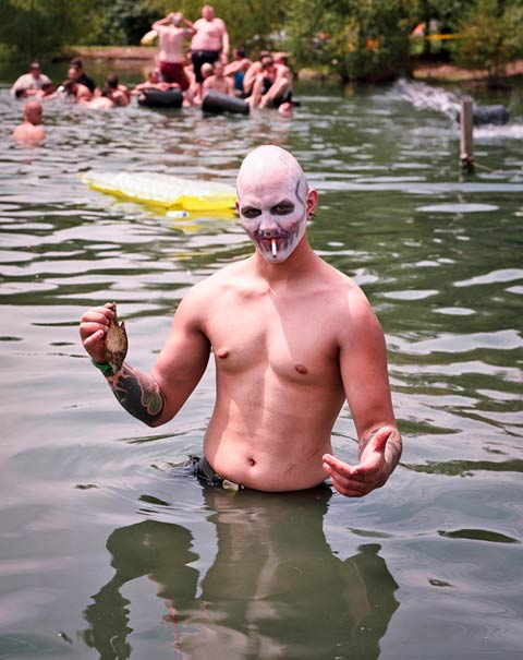 "Juggalos swimming in the campground's body of water, which they affectionately refer to as ""Lake Hepatitis."""