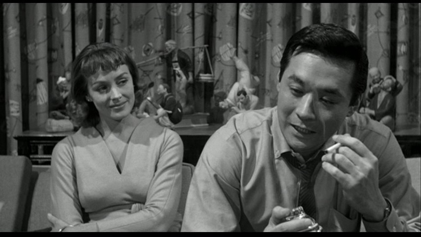 Romance blossoms between Christine Downes (Victoria Shaw) and Detective Joe Kojaku (James Shigeta) in  The Crimson Kimono .