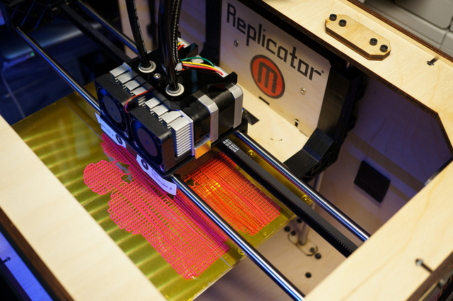 A MakerBot Replicator in action (Credit: Photo by Flickr user Osamu Iwasaki, used with Creative Commons license)