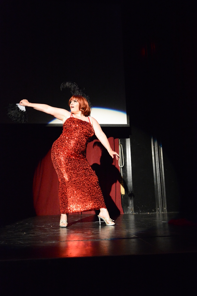 Performer Dixie Douya's strip-tease starts off glamorously enough.