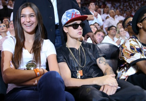 Haleigh Youtie sitting next to Justin Bieber at a Miami Heat game