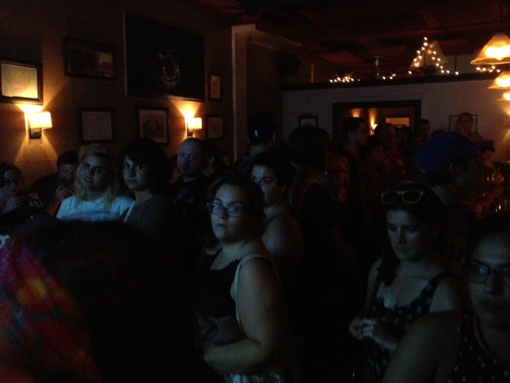 The crowd at Halyards; note the twisted face of the blonde on the left (Credit: Photo by author)