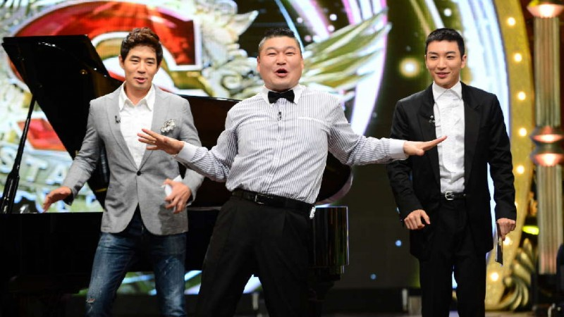 Korean M.C., comedian and wrestler Kang Ho-Dong (center)